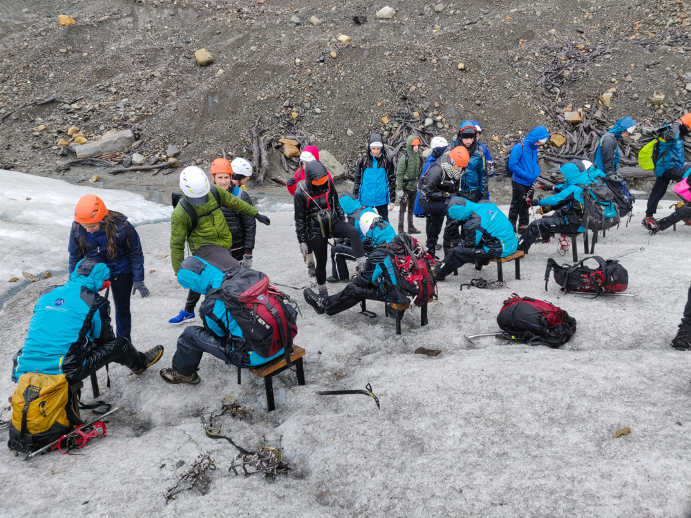 The group getting their crampons put on
