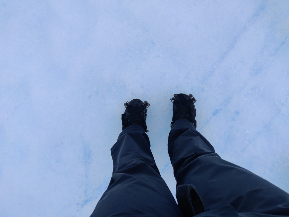 Looking down at my feet on the glacier