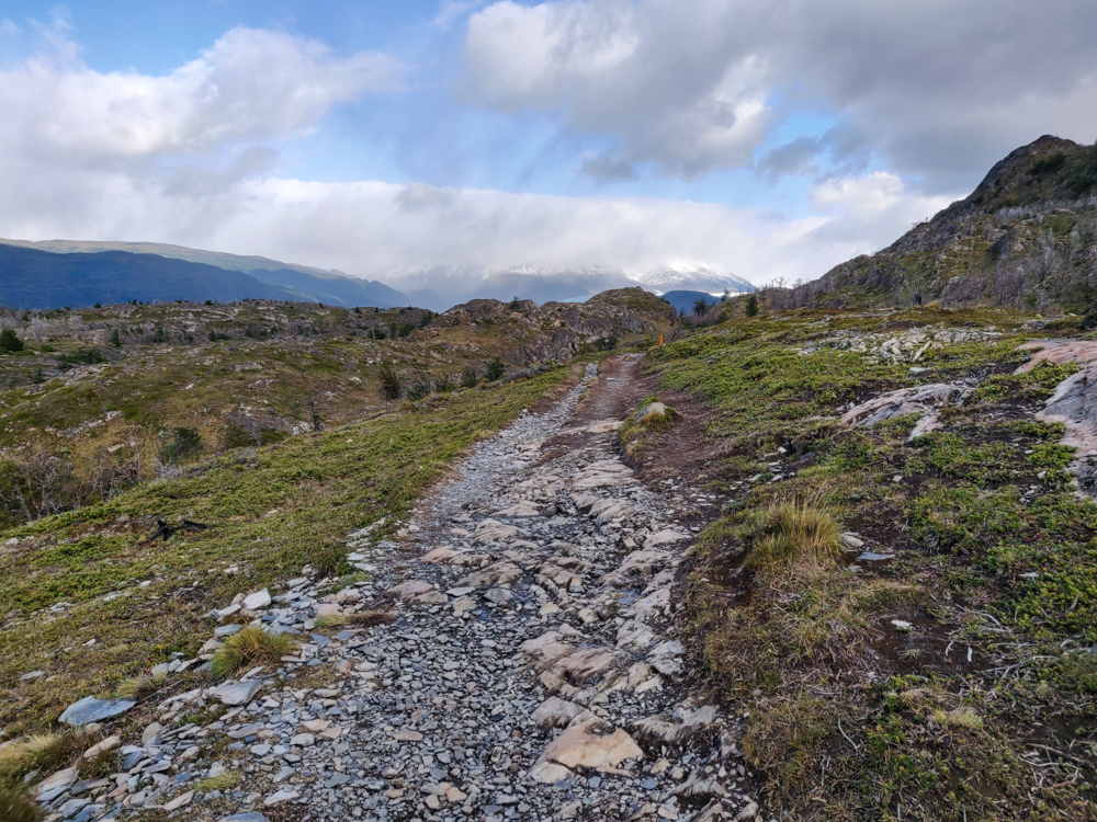 The hiking trail leading towards snowy mountains