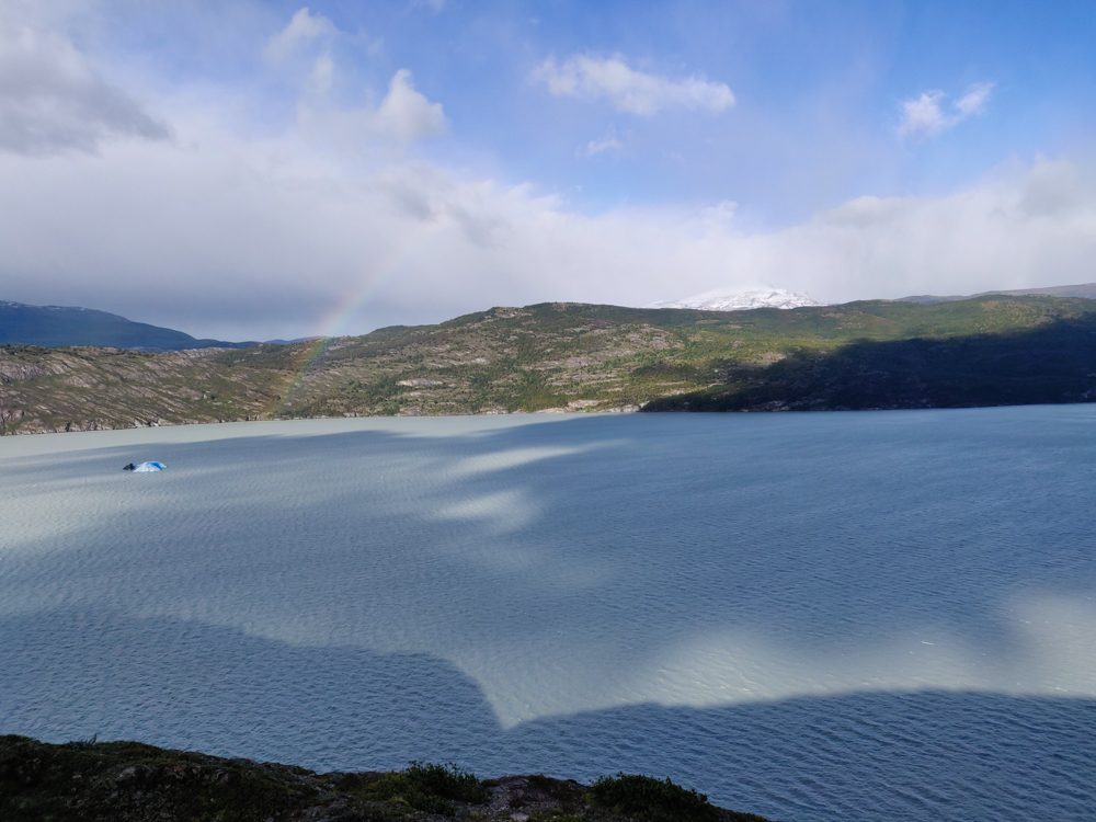 Grey Lake with a faint rainbow