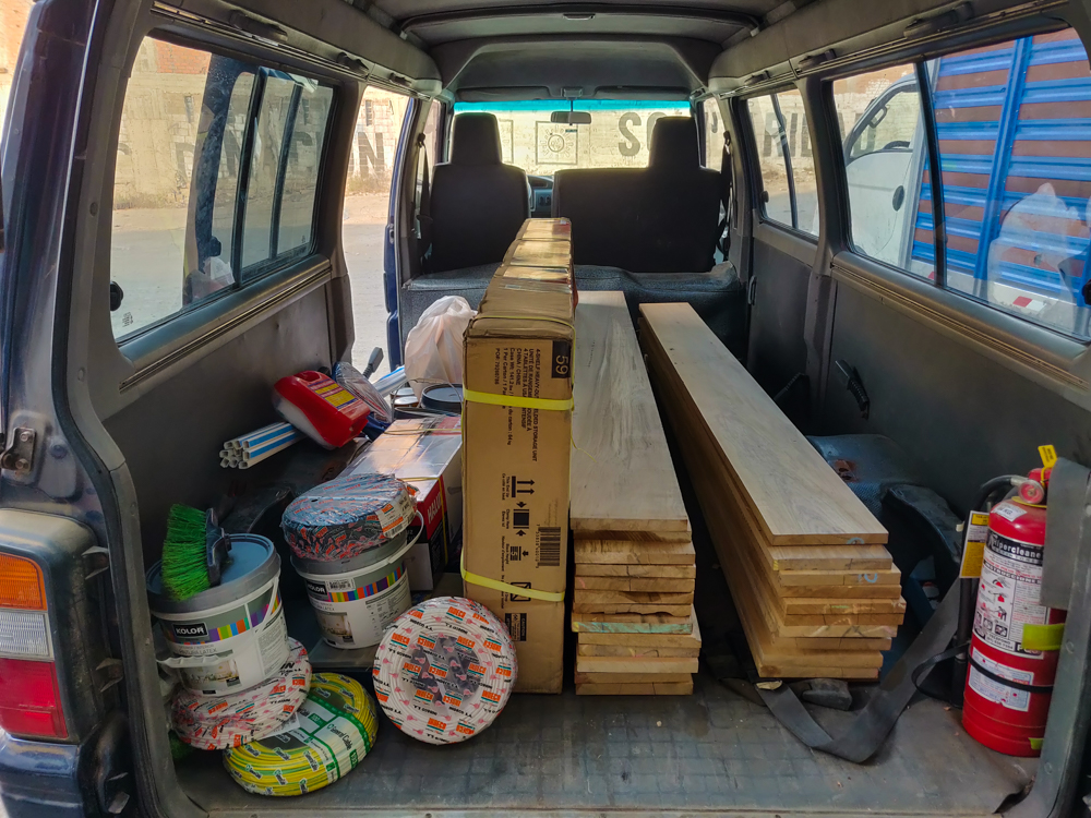 The van filled with wood and other supplies for the upcoming week