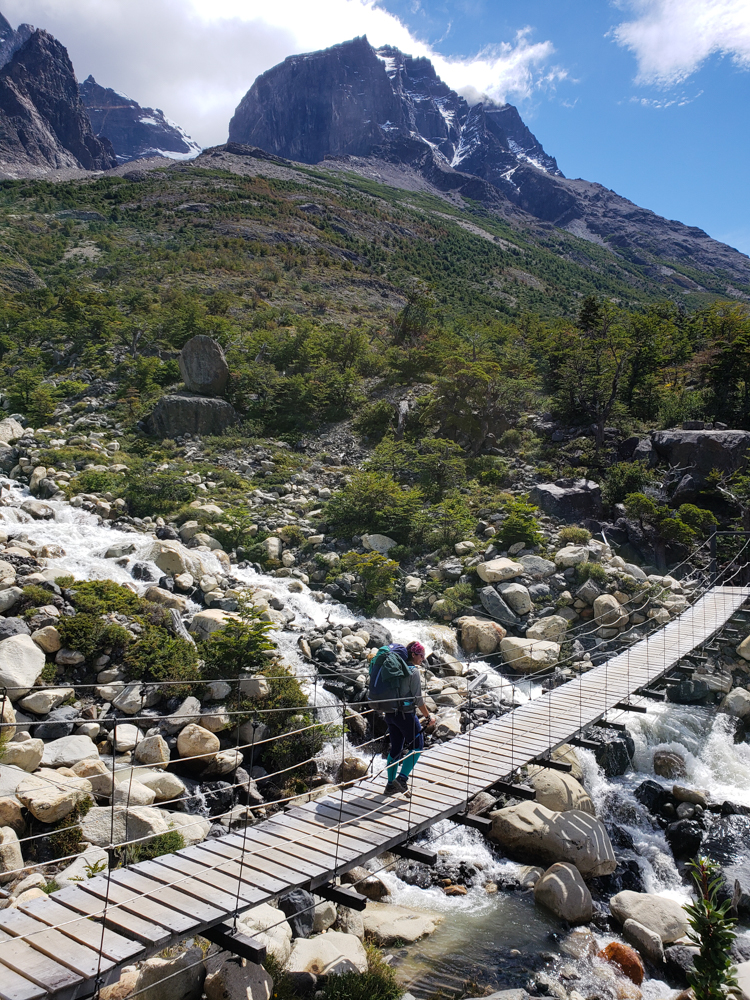 Me walking across a suspension bridge