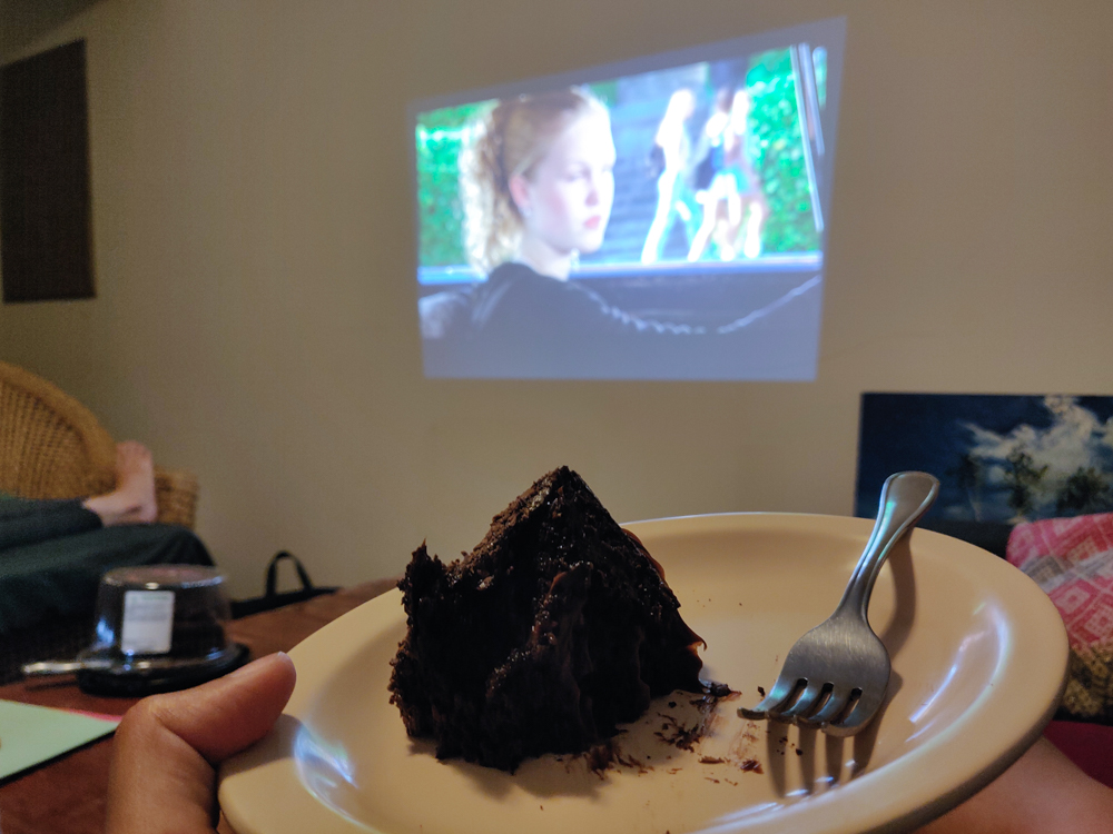 Projected movie on the wall and my cake plate!