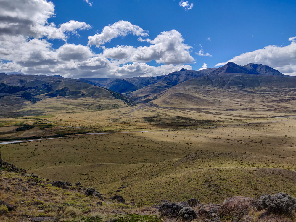 The road into El Chaltén and mountains behind it