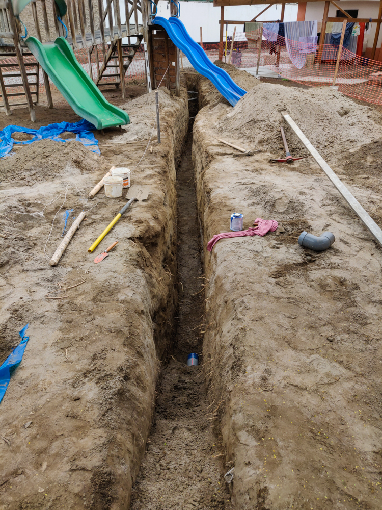 The septic trench stretching across the property and under the swing set
