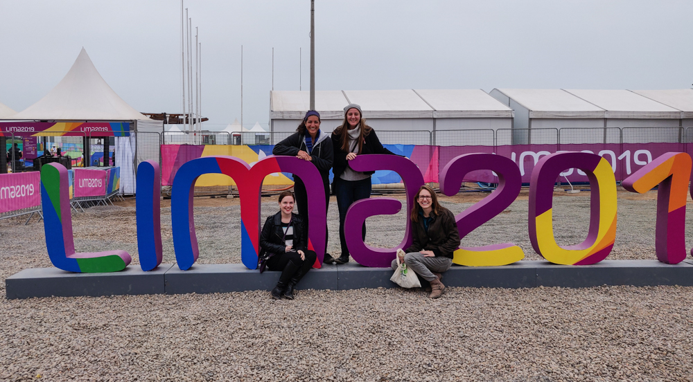 "Us with a Lima 2019 sign... and the ""9"" is cut off"