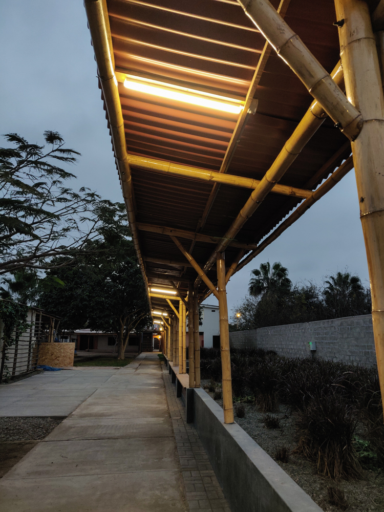 Linear lighting underneath the walkway roof shade