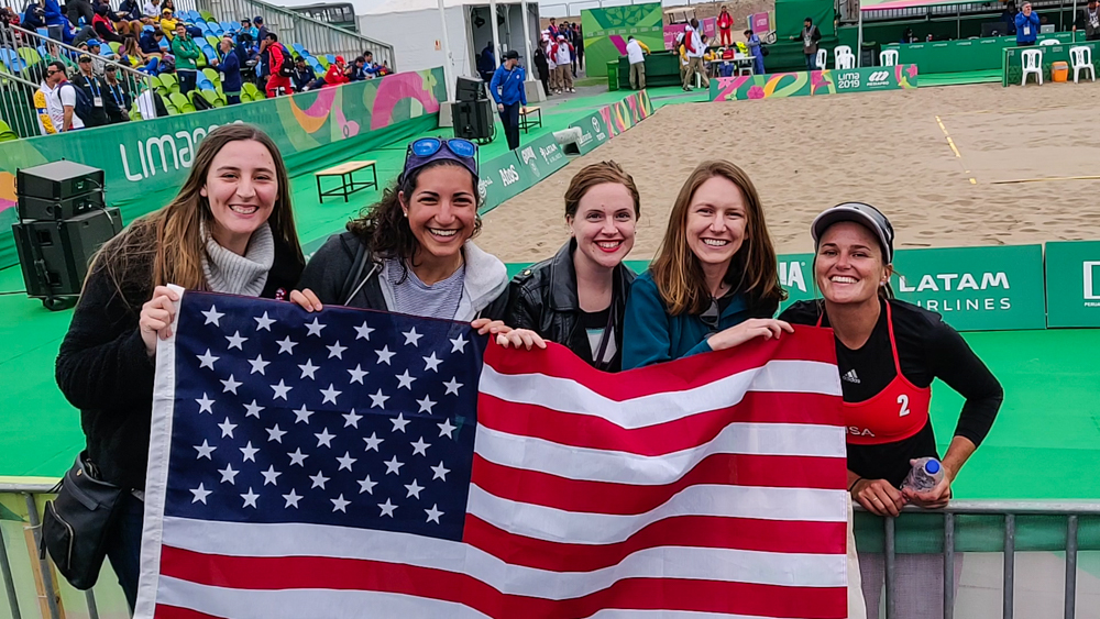 Us with an American flag at the beach volleyball court