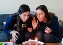 Blowing out our ?-shaped candles